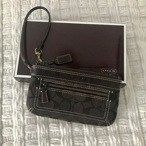 Dark brown Coach large wristlet with two pockets